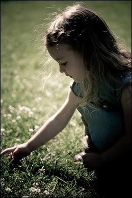little girl picking flower at brookside gardens in maryland