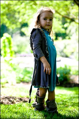 little girl posing for photograph at brookside gardens in maryland