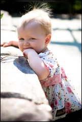 baby standing by wall at brookside gardens