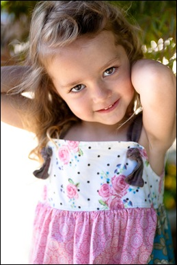 child posing for photograph at brookside gardens in maryland