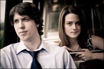man and woman sitting in metro car