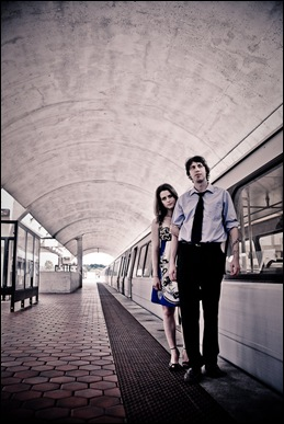 couple standing by dc metro car