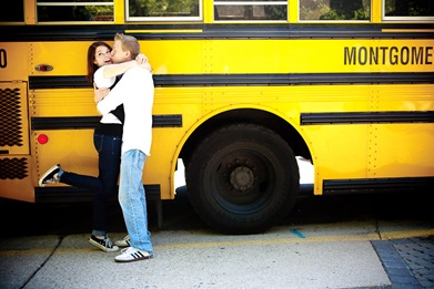 man and woman hugging in front of school bus  at Brookside Gardens in Wheaton MD