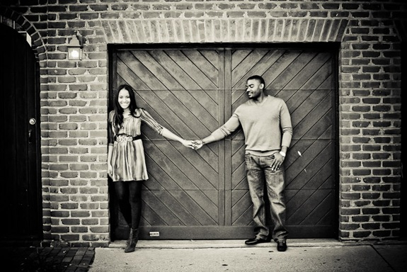 man and woman in front of garage in old town alexandria