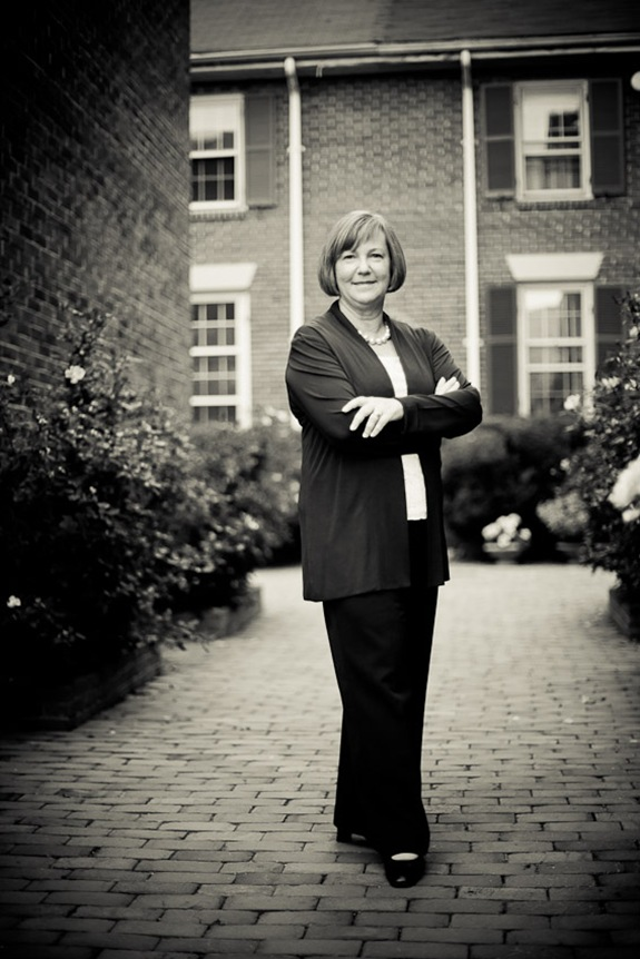 Eileen Kugler standing in walkway for business portrait in downtown alexandria va