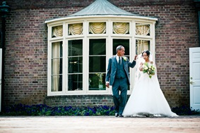 bride walking down isle  at the Newton White Mansion in Mitchellville MD