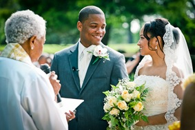 bride and groom on alter  at the Newton White Mansion in Mitchellville MD
