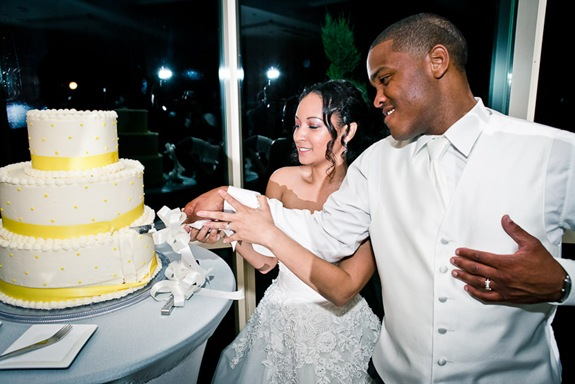 bride and groom cutting cake  at the Newton White Mansion in Mitchellville MD
