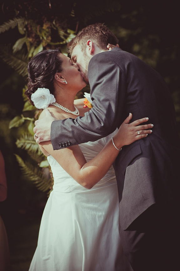 bride and grooms first kiss at Mt. Airy Mansion in Upper Marlboro Maryland