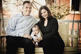 family sitting on front porch in Arlington VA
