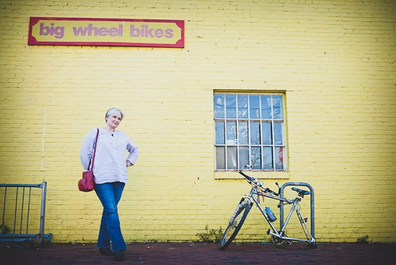 wide image of woman standing in old town alexandria