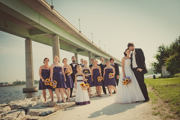 wedding party standing by severn river bridge in Annapolis MD
