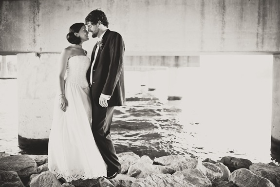 bride and groom together under bridge  in Annapolis MD