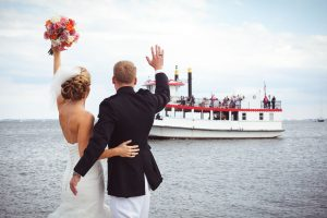 Bride-waiving-at-boat-naval-academy